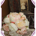 White and blush pink silk artificial bridal bouquet. A very romantic wedding bouquet design with a unique handle finish.
