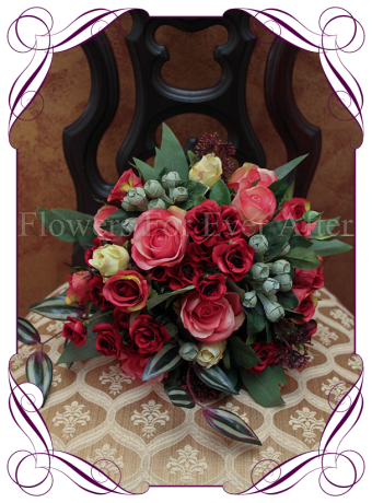 artificial bridal bouquet with red and pink roses
