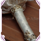 Vintage glamour, elegant bridal design. Features all hand made fabric flowers, each set with brooches. Fabrics used are in ivories, creams, champagnes, dusty pinks, apricots and golds, with scattered gold wired diamante crystals, gold metal loops and laces. brooch bouquet, bling bouquet