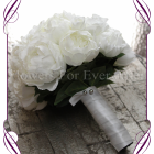 An elegant and romantic silk artificial white rose and peony bridal bouquet.