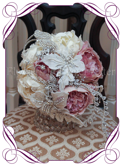 An incredible and unique bridal bouquet with all of the elements required for a romantic yet glamorous wedding bouquet style. This silk wedding bouquet has beautiful artificial peonies, with brooches, bling and jewels set on and underneath the design. A truly different bouquet design..