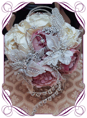 An incredible and unique bridal jeweled bouquet with all of the elements required for a romantic yet glamorous wedding bouquet style. This silk wedding bouquet has beautiful artificial peonies, with brooches, bling and jewels set on and underneath the design. A truly different bouquet design. Made in Melbourne!