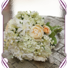 Pretty feminine bridal bouquet featuring lily of the valley, white roses, ranunculus, peach roses, snowball, hyacinth and foliages. A beautiful semi structured vintage/boho look