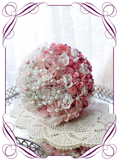 A beautiful button flower bridal bouquet with hombre design featuring our uniquely designed button flowers, pearls and beads.