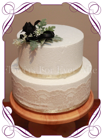 Black and white silk artificial flowers wedding cake decoration.