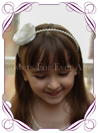 A sweet girls flower and pearl headband perfect for communions, confirmation and flower girls hair styles.