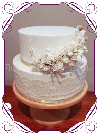 Unique ivory cake decoration, cake topper, with roses, rosettes, pearls and diamantes. Elegant yet unusual cake flowers.