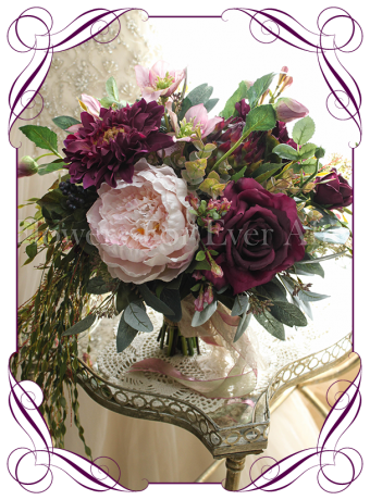 A unique and real looking silk bridal bouquet. This artificial wedding posy is set in a rustic free stucture with burgundy wine / marsala dahlia and roses, pink peonies, orchids, gum leaves and draping foliage