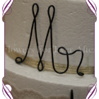Mr and Mrs wire word wedding cake topper / decoration.