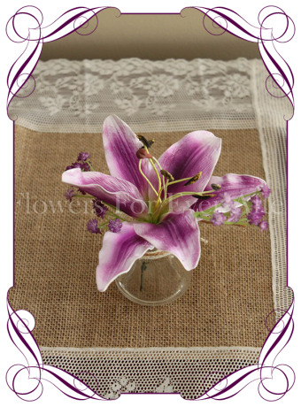 Purple lily and baby's breath silk flower artificial wedding table decoration. Perfect for jars and small vases in a rustic theme.