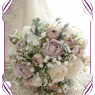 A truly unique and romantic silk bridal bouquet style with sort after romantic artificial blooms. With roses, baby's breath, and foliage all in stunning vintage tones, it is a design perfect for a large number of wedding colour themes.