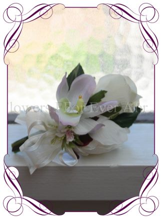 Ladies pin corsage with silk artificial ivory white roses and lilac mauve orchid.