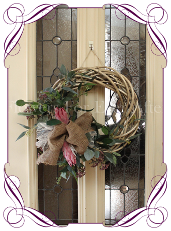 Rustic silk artificial pink protea and Australian native Christmas or decorative door wreath. With burlap and lace on a wooden wreath. Made in Melbourne. Ships worldwide.