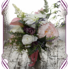 Rustic silk artificial flower bridal bouquet with dahlia, peony, roses, calla lilies in pink, white and purple.