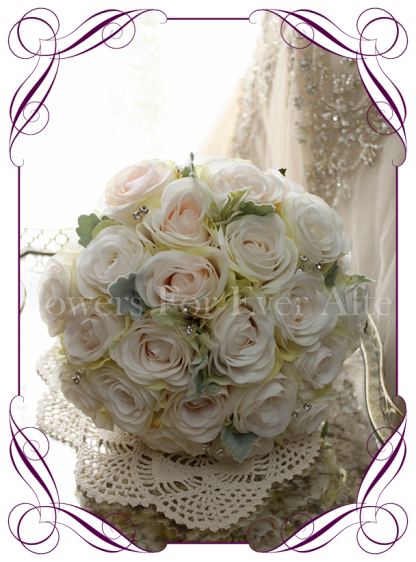 Ivory and blush silk artificial roses in a class romantic bridal bouquet design. An elegant posy in a simple clean style with added diamantes / bling.Made in Melbourne. Custom order. World wide shipping.
