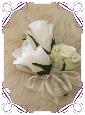 Ivory silk artificial roses in a classic design. An elegant corsage in a simple clean style. Made in Melbourne. Custom order. World wide shipping.