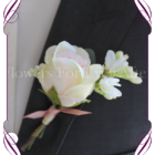 Glenda/Jessica Grooms boutonniere featuring silk artificial rose and white flower on foliage. Made in Melbourne, Custom Orders available.