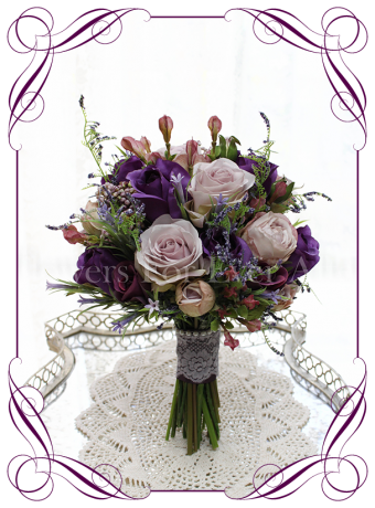 Silk flower bouquet with a mix of purple colors, including Cadbury purple, mauve and lavender. With roses, berries and fern. Made in Melbourne. Ships worldwide. Lace and pearls on handle.