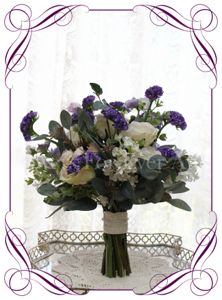 A garden rustic silk flower bridal bouquet in purple, ivory, lilac, and blush pink. Made in Melbourne. Shipping world wide.
