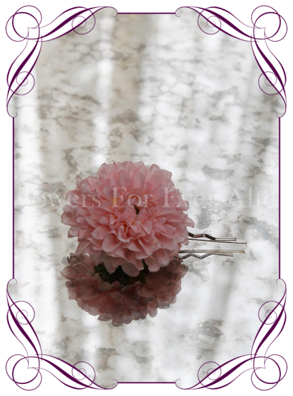pink silk artificial hair flower on pin.