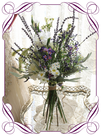 Wild flower silk artificial bridal bouquet. Perfect for rustic boho whimsical weddings with meadow flowers including lavender, daisies and purple mist.