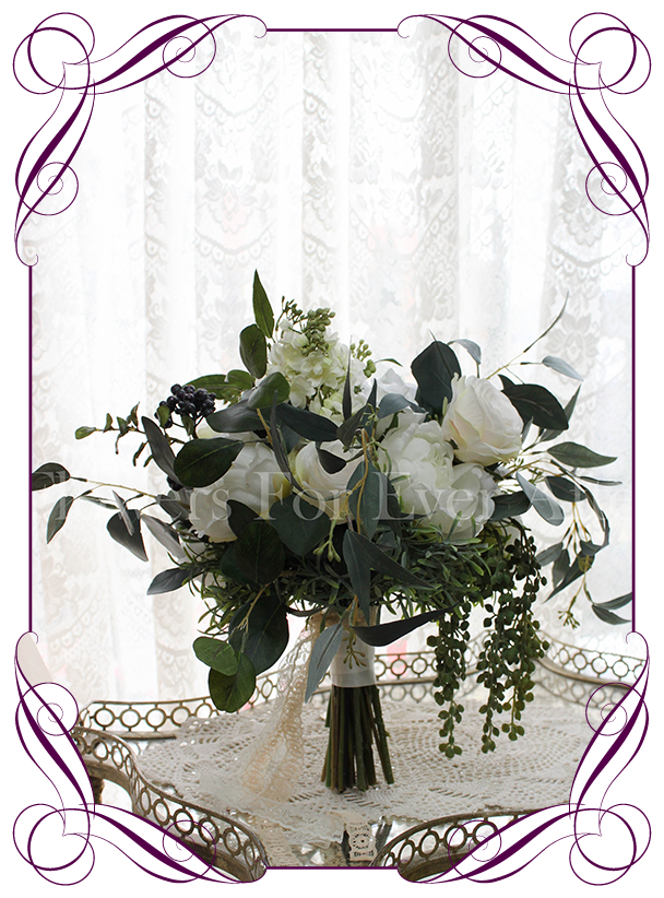 Cascading posy bridal silk artificial posy bouquet. With white rose, lilacs, peonies, cream ranunculi, navy blue berries and Australian native foliage. Made in Melbourne, shipping worldwide.