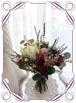 An elegant artificial bridal bouquet with silk protea, burgundy peony and lavender. Loose rustic silk bouquet, boho style. Made in Australia. Buy online, ship worldwide