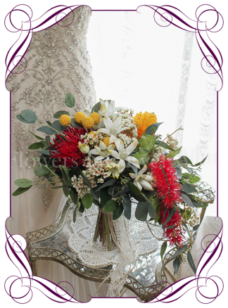 An elegant artificial bridal cascading / messy rustic posy with silk red bottle brush, yellow banksia, billy balls, Australian natives with eucalypt and gum leaves. Loose rustic silk bouquet, boho style. Made in Australia. Buy online, ship worldwide