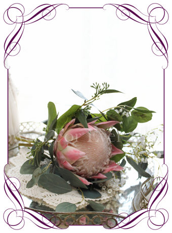 Small rustic wedding posy with artificial silk pink protea and Australian native foliage and baby's breath. Junior bridesmaids or flower girl bouquet. Made in Melbourne. Shipping worldwide.