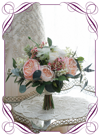 Blush pink silk artificial bridal bouquet with peonies, roses, native gum in an loose rustic posy. Made in Melbourne. Shipping worldwide