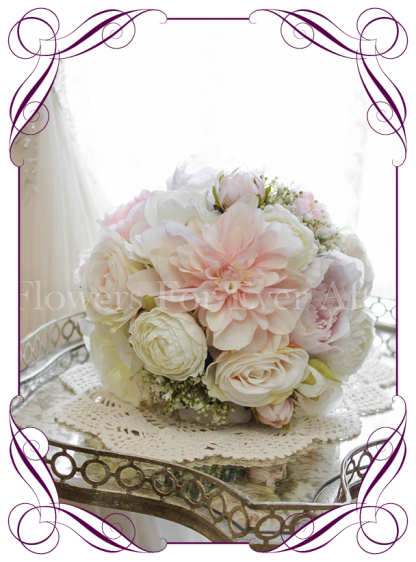 An elegant and romantic silk artificial wedding bridesmaids flower bouquet with pastel colours in blush, lilac, off white / ivory. With peonies, roses, baby's breath / gyp dahlia and gorgeous ranunculi. Classic and sweet. Shipping world wide. Buy online