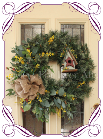 Christmas door wreath with Australian native gum and gumnuts. Burlap, wattle, wooden bird house and Australian native gum flowers.