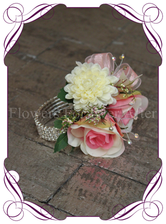 silk artificial pink and cream ivory rose design for a formal / deb / prom / wedding ladies wrist corsage . Shipping world wide. Made in Melbourne Australia.