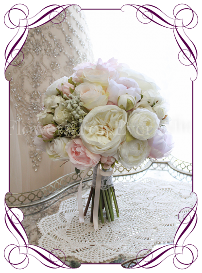 An elegant and romantic silk artificial wedding bridal flower bouquet with pastel colours in blush, lilac, off white / ivory. With peonies, roses, baby's breath / gyp dahlia and gorgeous ranunculi. Classic and sweet. Shipping world wide. Buy online