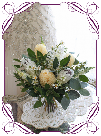 High quality realistic silk artificial bridal posy wedding bouquet with soft yellow banksia, ivory white protea, mix Australian native flowers and gum leaves. Made in Melbourne Australia, shipped world wide. Buy online.