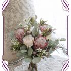 High quality realistic silk artificial bridal wedding bouquet with pink protea, blush ivory roses and Australian Native gum leaves and flowers. Made in Melbourne Australia, shipped world wide. Buy online.