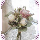 High quality realistic silk artificial bridesmaid posy wedding bouquet with pink protea, blush ivory roses and Australian Native gum leaves and flowers. Made in Melbourne Australia, shipped world wide. Buy online.