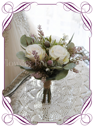 High quality realistic silk artificial flowergirl posy wedding bouquet with pink protea, blush ivory roses and Australian Native gum leaves and flowers. Made in Melbourne Australia, shipped world wide. Buy online.