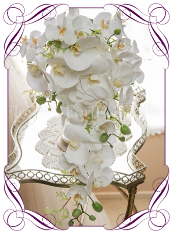 Contemporary simple falling phalaenopsis orchid cascading white bridal bouquet silk artificial wedding flowers. Real touch orchids in a modern tear bouquet. Made in Australia. Shipping worldwide. Buy online