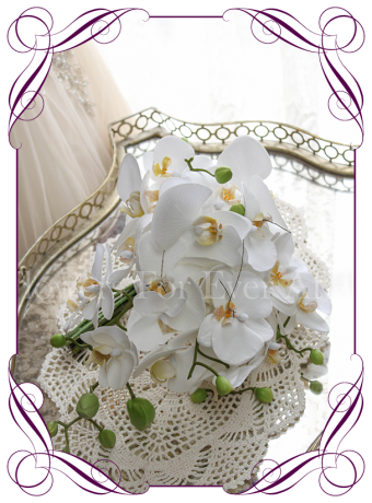 Contemporary simple falling phalaenopsis orchid cascading white bridesmaid bouquet silk artificial wedding flowers. Real touch orchids in a modern tear bouquet. Made in Australia. Shipping worldwide. Buy online