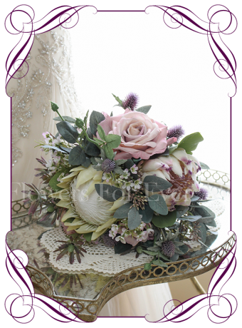 High quality realistic silk artificial bridal posy wedding bouquet with pastel tones of dusty pink roses, ivory king protea, succulents, ivory roses, thistle, leucondendron and other Australian Native flowers and gum leaves. Made in Melbourne Australia, shipped world wide. Buy online.