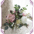 High quality realistic silk artificial bridesmaid posy wedding bouquet with pastel tone of dusty pink roses, ivory roses, thistle, leucondendron and other Australian Native flowers and gum leaves. Made in Melbourne Australia, shipped world wide. Buy online.