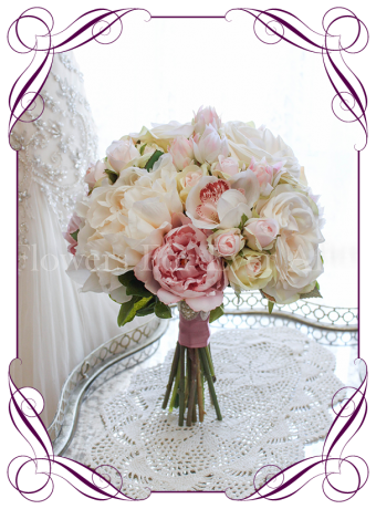 An elegant and romantic silk artificial wedding flower bouquet with pastel colours in blush, pink, off white / ivory. With peonies, roses, protea buds and orchids. Classic and sweet. Shipping world wide. Buy online