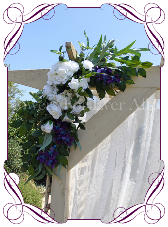Silk artificial blue galaxy orchids, white hydrangea and rose wedding arbor arch table decoration. Can be a package with matching tieback flowers. Made in Australia. Buy online.