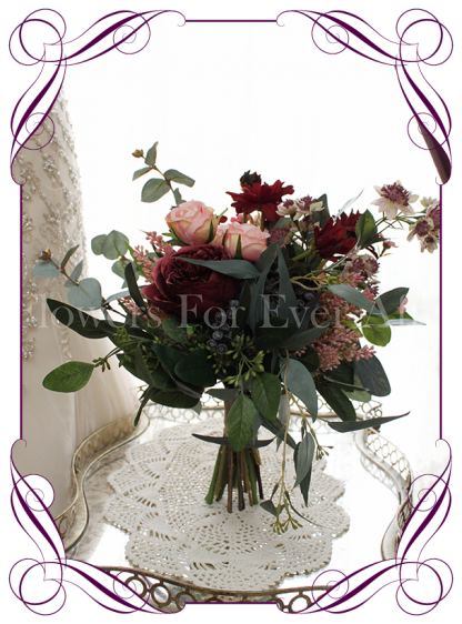 Silk artificial rustic bridesmaids posy bouquet with burgundy and apricot pink roses, peonies, gum nuts and native Australian foliage.