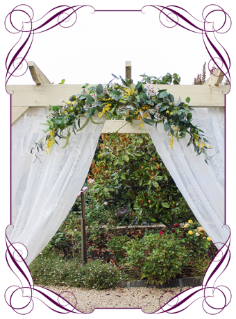 Silk artificial yellow wattle white was, gum nuts and native Australian gum and pink protea wedding arbor arch table decoration. Can be a package with matching tieback flowers. Made in Australia. Buy online.