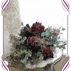A dark red protea Australian native silk artificial bridal posy bouquet flowers. Earthy wood forest feel in a rustic bouquet design. Made in Melbourne. Ship worldwide. Buy online.