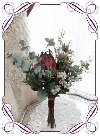 A dark red protea Australian native silk artificial bridesmaids posy bouquet. Earthy wood forest feel in a rustic bouquet design. Made in Melbourne. Ship worldwide. Buy online.