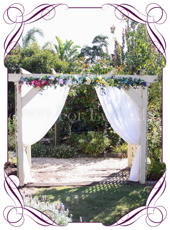 Silk artificial rainbow multicolor colourful wedding arbor arch table decoration. Can be a package with matching tieback flowers. Made in Australia. Buy online.