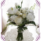 Silk artificial white classic elegant bridesmaid posy bouquet with roses, peonies, lilies, ranunculi, baby's breath and fine foliage.